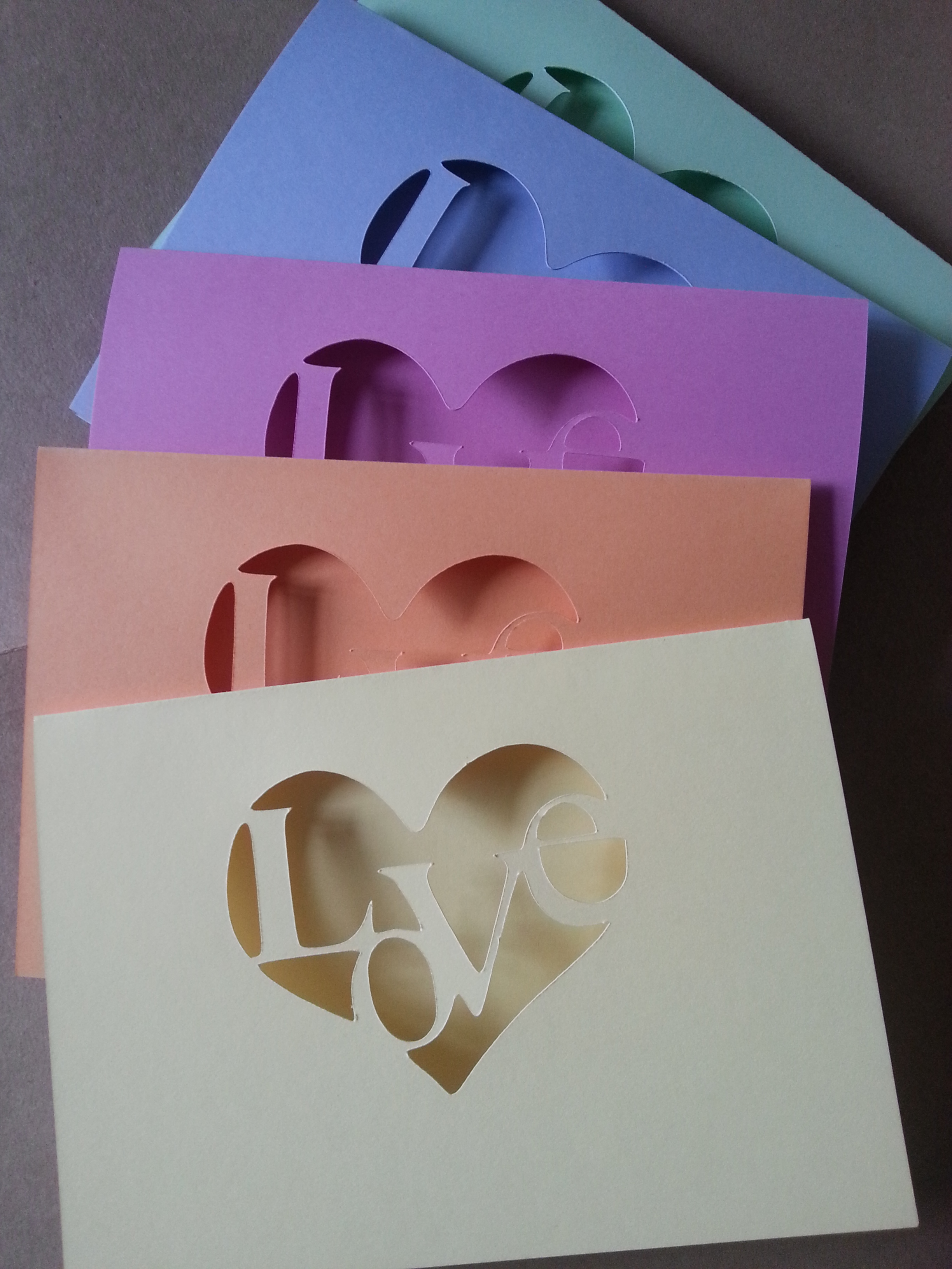 Rainbow love card collection cut out design